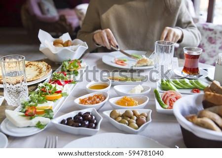 Young woman having a mediterranean breakfast, eats Healthy tropical breakfast, smoothie bowl with tr Stock photo © galitskaya