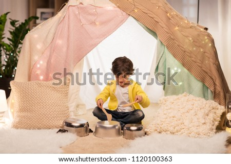 boys with pots playing in kids tent at home Stock photo © dolgachov