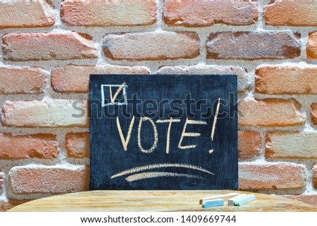 Chalk board with the word VOTE! drown by hand and chalks on wood Stock photo © marylooo