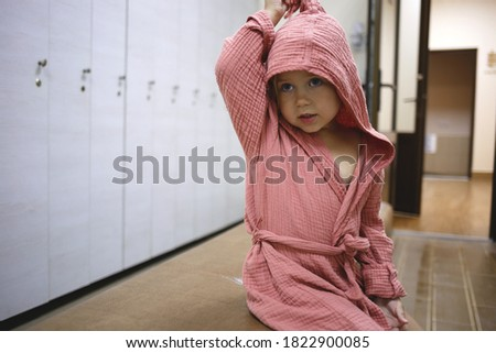 Portrait of little girl in hat relaxing in swimming pool, swims on inflatable yellow mattress Stock photo © Illia