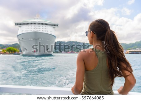 Woman tourist on outdoor shore excursion looking at cruise ship boat docked at port of call harbour  Stock photo © Maridav