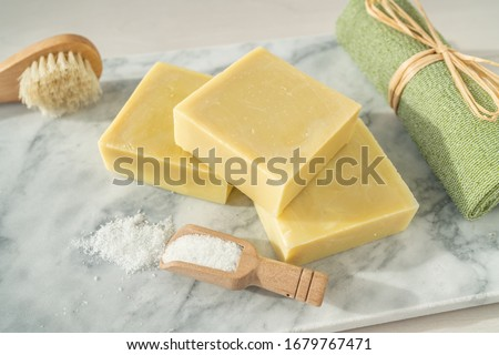 Handmade natural soap bars with epsom salt and scrubbing towel for skincare exfoliation spa therapy. Stock photo © Maridav