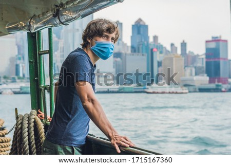 A young man on a ferry in Hong Kong Tourists fear the 2019-ncov virus. Medical masked tourists Stock photo © galitskaya
