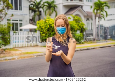 Man in a small town in a medical mask uses a sanitizer because of a coronovirus epidemic BANNER, LON Stock photo © galitskaya