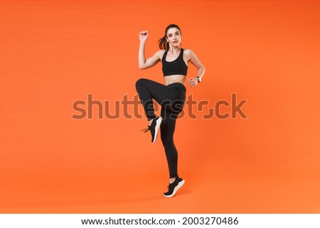 dancing woman in sportswear in jump with rised hands Stock photo © Paha_L