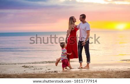 family walking on the beach stock photo © epstock