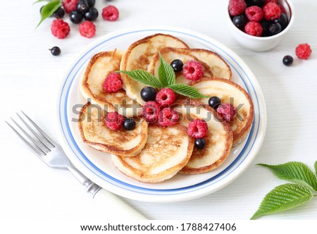 pancakes with berries stock photo © zhekos