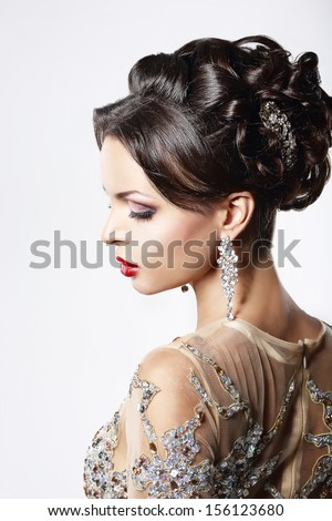 Jewelry. Portrait of Gorgeous Exquisite Woman with Shiny Earrings. Refinement Stock photo © gromovataya