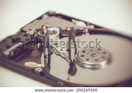 Miniature business people on top of hard drive. Business concept Stock photo © Kirill_M