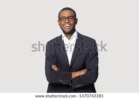 Portrait of a happy African-American young businessman isolated over white background Stock photo © deandrobot