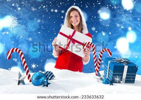 composite image of pretty girl in santa outfit holding gift stock photo © wavebreak_media