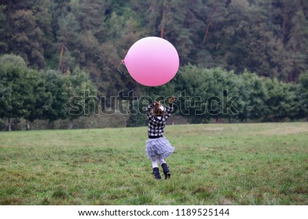 Little girl plays with big inflatable ball in park in afternoon. Parents observe of it sitting on la Stock photo © Paha_L
