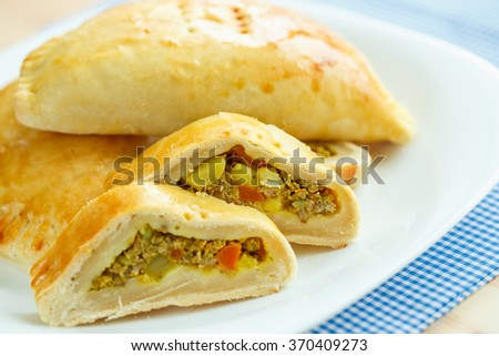 pie stuffed with meat on a white plate and blue checkered tablec stock photo © vlad_star