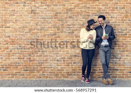 gelukkig · smartphone · park · vrouwen · paar - stockfoto © deandrobot