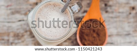 Drink from carob and kerob powder in a wooden spoon BANNER, long format Stock photo © galitskaya
