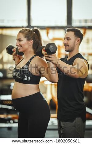 Hamile kadın dambıl personal trainer spor salonu kadın Stok fotoğraf © Lopolo