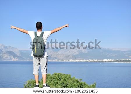 Homem brasão água linha do horizonte labareda confete Foto stock © wavebreak_media