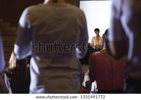 背面図 混血 観客 アジア 女性実業家 ストックフォト © wavebreak_media