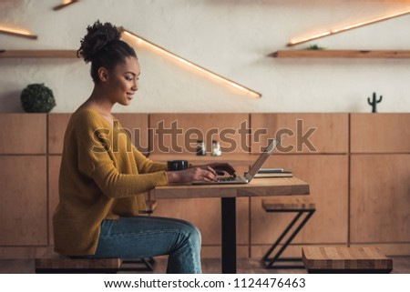 Side view of young African-American female architect using digital tablet in modern office Stock photo © wavebreak_media