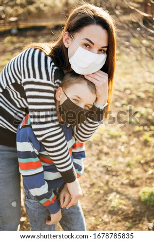 Caring mother hugs a masked child to protect him from the virus Stock photo © ruslanshramko