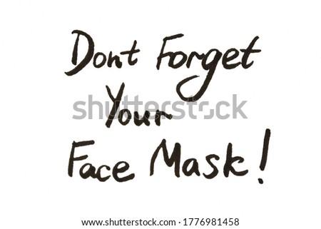 Medical face mask with coronavirus written on it on white background. Best protection from coronavir Stock photo © DenisMArt