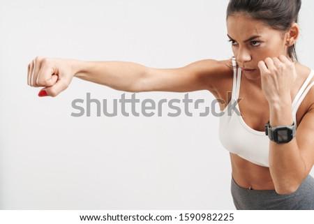 Afbeelding brunette jonge vrouw sportkleding boksen training Stockfoto © deandrobot