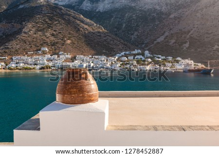 Kamares town with traditional white houses on Sifnos island on sunset. Greece Stock photo © dmitry_rukhlenko