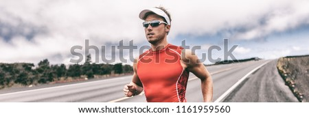 Triathlon corredor homem corrida estrada panorâmico Foto stock © Maridav