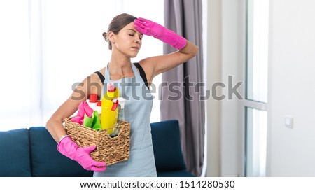 tired woman with bucket of cleaning stuff at home Stock photo © dolgachov