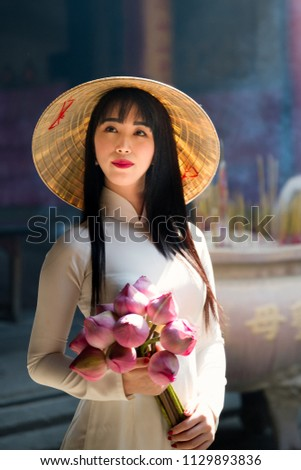 Young woman tourist in a traditional Vietnamese hat travels to Vietnam BANNER, LONG FORMAT Stock photo © galitskaya