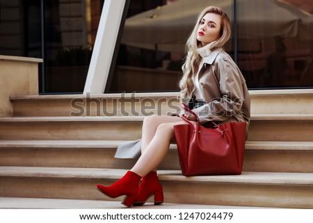 portrait of sitting woman with handbag stock photo © phbcz