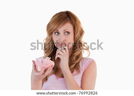 Blond-haired woman perplexed concerning her broken piggybank on a white background Stock photo © wavebreak_media