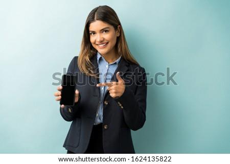 красивый женщины костюм указывая копия пространства Постоянный Сток-фото © wavebreak_media