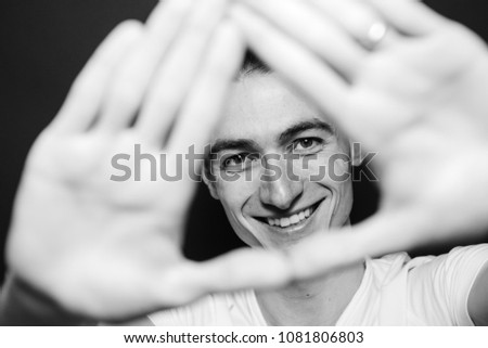 close up of smiling businessman with his palm up against a white background stock photo © wavebreak_media