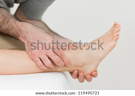 Physiotherapist working on the shin bone of a patient in a room Stock photo © wavebreak_media