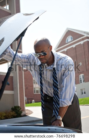 man having a bad day checks his car to figure out what the probl stock photo © dacasdo