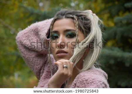 Stare. Outdoors portrait of beautiful woman model in pink blosso Stock photo © Victoria_Andreas