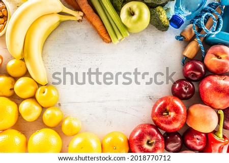 Dumbells made of broccoli with water bottle, carrots and green a stock photo © snyfer