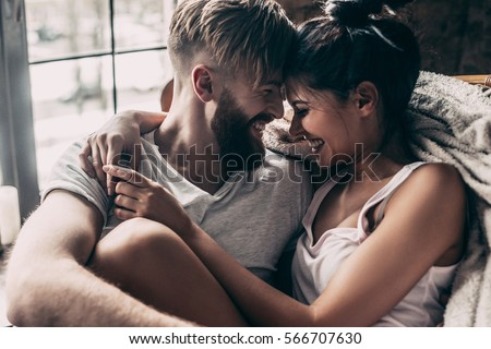 casual couple embracing and looking at you Stock photo © feedough