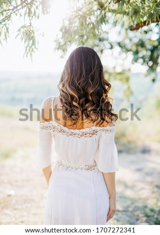 Beautiful young brunette girl wearing white summer dress and flower chaplet in poppy filed Stock photo © Nejron