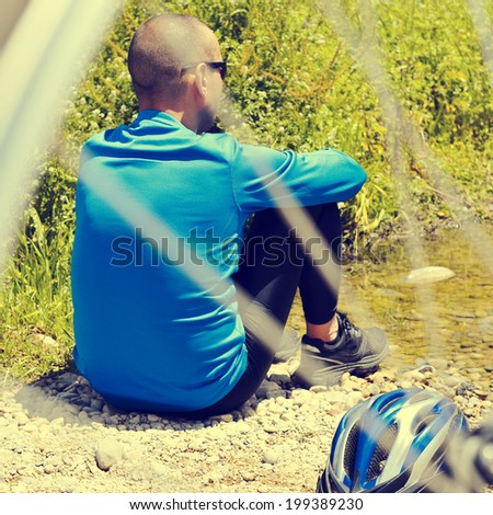 cyclist getting some rest at the riverside with a retro filter e Stock photo © nito