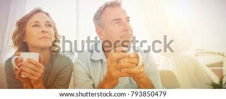 composite image of happy mature couple drinking coffee on a benc stock photo © wavebreak_media