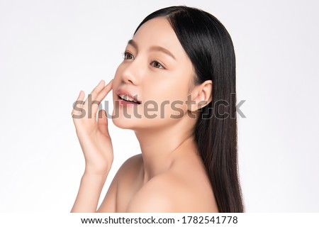 Close-up portrait of beautiful young asian model, isolated over white background Stock photo © deandrobot