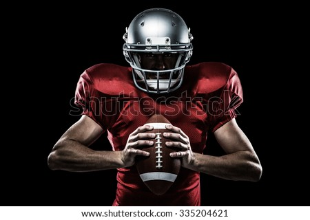 Composite image of american football player holding ball while c Stock photo © wavebreak_media
