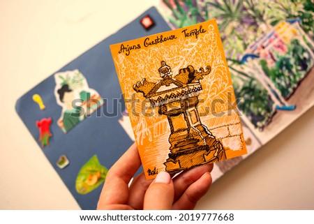 Woman artist hands drawing with gel ink pen in sketchbook Stock photo © deandrobot