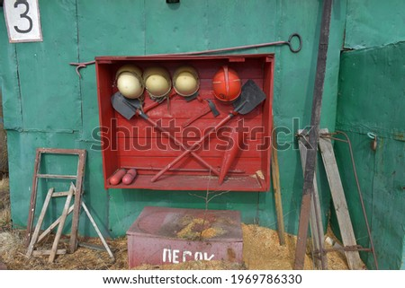 sand bucket painted in red with fire sign and sand to extinguish Stock photo © meinzahn