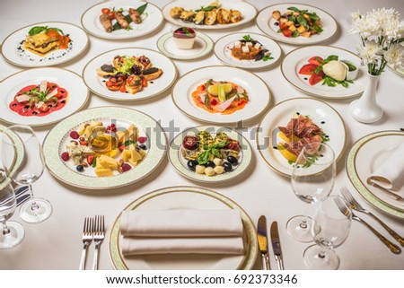 Fork and knife on table, food ingredients, many vegetables around Stock photo © zurijeta