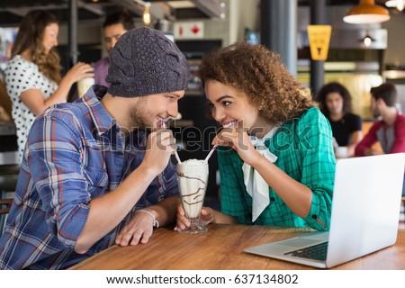 Happy couple having milkshake Stock photo © wavebreak_media
