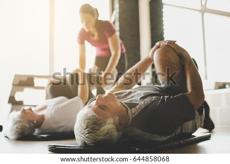 Senior woman and man doing assisted floor exercises with physiot Stock photo © Kzenon