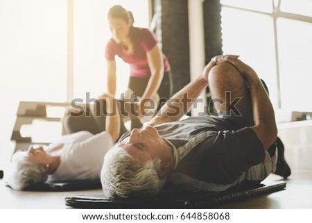 starszy · kobieta · człowiek · piętrze · gimnastyka · biuro - zdjęcia stock © kzenon